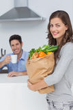 Attractive woman holding groceries bag Royalty Free Stock Images
