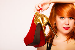 Attractive woman holding high heel shoes. Royalty Free Stock Image