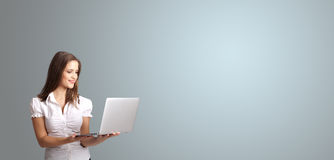 Attractive woman holding a laptop with copy space Royalty Free Stock Images