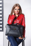 Attractive woman holding a leather bag Stock Photo