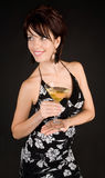 Attractive Woman Holding a Martini Stock Images