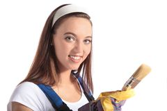 Attractive woman holding a paint brush Stock Image