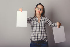 Attractive woman holding paper blank in her hands Stock Photo