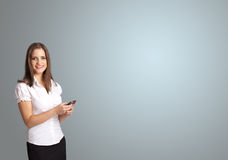 Attractive woman holding a phone with copy space Royalty Free Stock Photography
