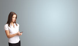 Attractive woman holding a phone with copy space royalty free stock photos
