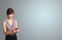 Attractive woman holding a phone with copy space Stock Photos