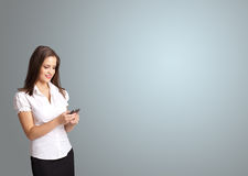 Attractive woman holding a phone with copy space Stock Images