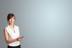 Attractive woman holding a phone with copy space Stock Photo