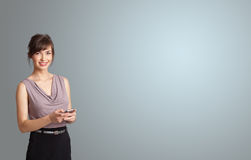 Attractive woman holding a phone with copy space Royalty Free Stock Image