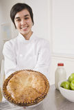 Attractive woman holding pie. Stock Photos