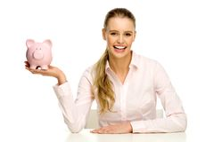 Attractive woman holding piggy bank Royalty Free Stock Image