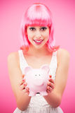 Attractive woman holding piggy bank Royalty Free Stock Images