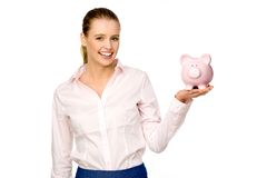 Attractive woman holding piggybank. Attractive young woman over white background Stock Photography