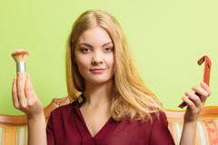 Attractive woman holding powder brush. Make up. Young attractive pretty woman girl holding powder brush. Fashion and make up Stock Photos