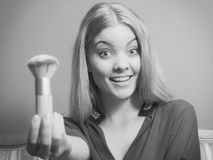Attractive woman holding powder brush. Make up. Young attractive pretty woman girl holding powder brush. Fashion and make up. Black and white photo Stock Photography