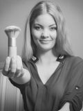 Attractive woman holding powder brush. Make up. Young attractive pretty woman girl holding powder brush. Fashion and make up. Black and white photo Royalty Free Stock Photography