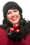Attractive Woman Holding Red Ornaments Stock Photo