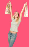 Attractive woman holding shopping bags Royalty Free Stock Images