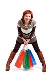 Attractive woman holding shopping bags Stock Photography