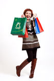 Attractive woman holding shopping bags Stock Images