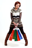 Attractive woman holding shopping bags Stock Photos