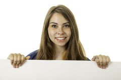 Attractive woman holding a sign Stock Photos