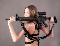 Attractive woman holding sniper rifle Royalty Free Stock Image