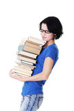 Attractive woman holding stack of books. Royalty Free Stock Images