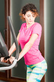 Attractive woman holding the stepper handle and exercising Royalty Free Stock Image