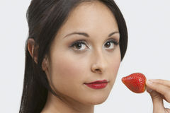 Attractive Woman Holding Strawberry Royalty Free Stock Photos