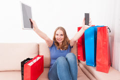 Attractive woman holding tablet and smartphone acting happy Stock Photos