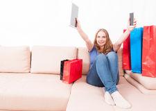 Attractive woman holding tablet and smartphone acting happy Stock Photo