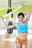 Attractive woman holding towel at gym Royalty Free Stock Images