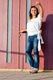 Attractive woman holding up a house Royalty Free Stock Photo