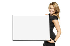 Attractive Woman Holding Up a  Poster - Isolated Royalty Free Stock Photography