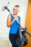Attractive woman holding vacuum cleaner Royalty Free Stock Photos