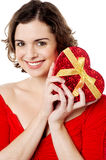 Attractive woman holding valentine gift Stock Image
