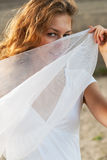 Attractive woman holding white scarf Stock Image
