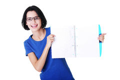 Attractive woman holding workbook in front, copy space. Stock Image
