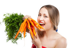 Attractive woman holds bunch of carrots Stock Photo