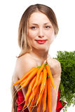 Attractive woman holds bunch of carrots Stock Photos