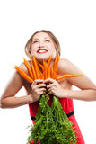 Attractive woman holds bunch of carrots Stock Images
