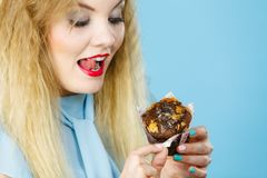 Attractive woman holds cake in hand royalty free stock photography