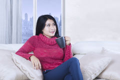 Attractive woman holds hot coffee Royalty Free Stock Images