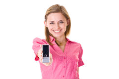 Attractive woman holds mobile phone, isolated Royalty Free Stock Photo