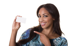 Attractive woman holds up a blank business card. Fashionable woman with a perfect smile, holds up a business card Stock Photo