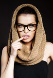 Attractive woman with a hood and glasses Royalty Free Stock Photos