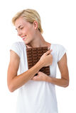 Attractive woman hugging bar of chocolate Royalty Free Stock Photo