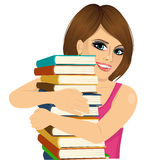 Attractive woman hugging stack of books happily Stock Images