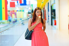 Attractive woman with ice cream Stock Images